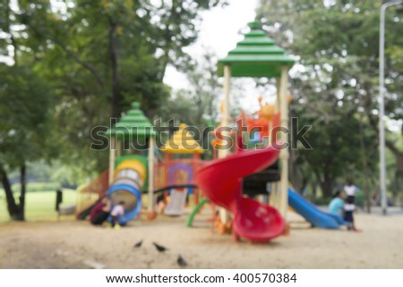 Blurred image of playground for children in park