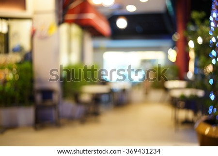 Blurred image of restaurant / coffee shop for backgrounds uses. - stock photo