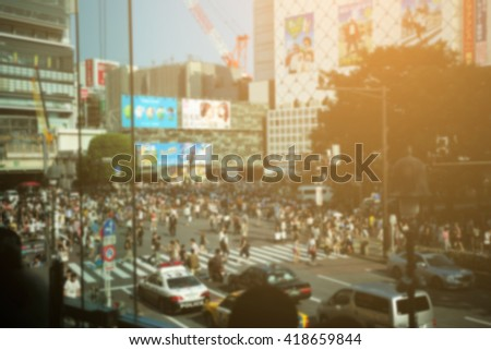 blurred image of shibuya crosswalk at tokyo japan and cross process with soft flare filter - stock photo