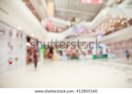 Blurred image of shopping mall. - stock photo