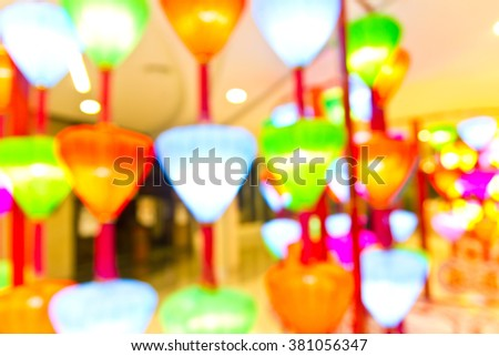 Blurred image of  shopping mall : decorate with festival light