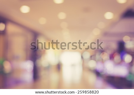 blurred image of shopping mall with bokeh, vintage color - stock photo
