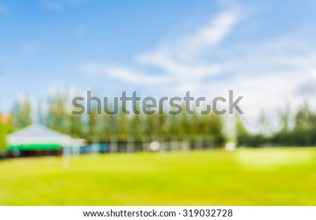 blurred image of soccer field at school on day time  for background usage . - stock photo