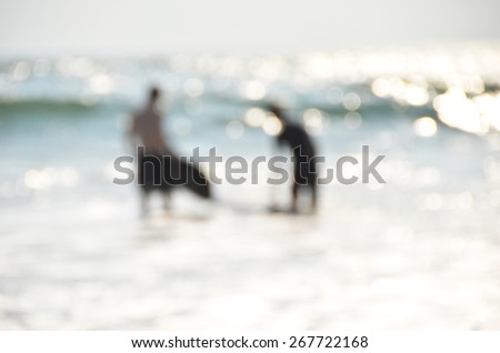 Blurred image of surfers  - stock photo
