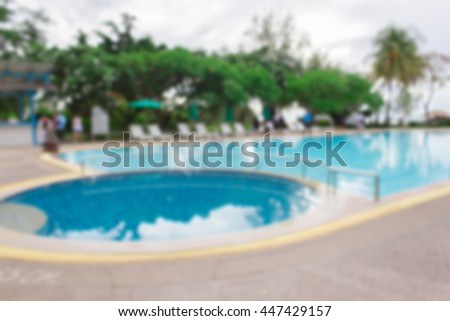 blurred image of swimming pool in the hotel