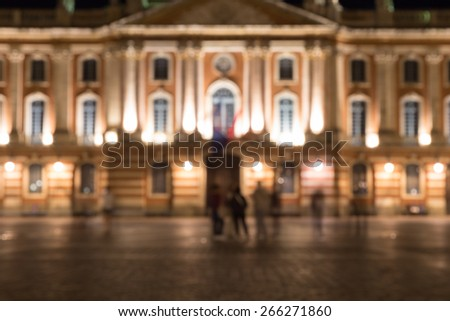 Blurred image of the Captiole de Toulouse and Place du Capitole at night - stock photo