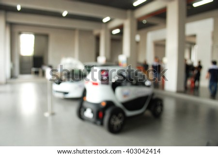 Blurred image of the car show. electric car. go green - stock photo