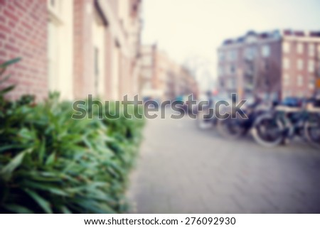 Blurred image of the city. - stock photo