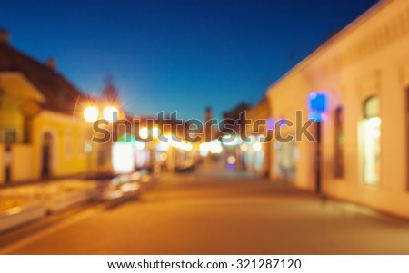 Blurred image of town in dusk - stock photo