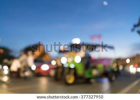 Blurred image of Tuk Tuk  with Giant swing and wat suthat at twilight moment for background uses. - stock photo