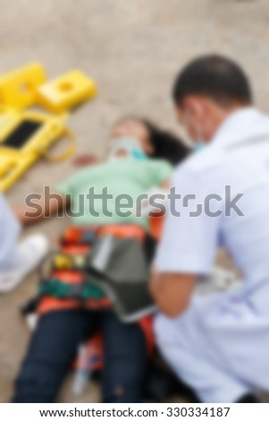 Blurred image of unidentified accident people by car waiting medicine or doctor at the site of accident.
