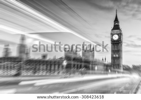 Blurred image of Westminster Bridge and Big Ben at night. - stock photo