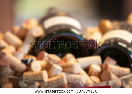 Blurred image of Wine bottle and corks. - stock photo