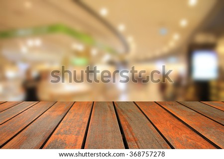 blurred image wood table and abstract  department store shopping mall center and people background - stock photo