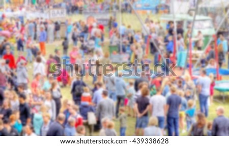 blurred images from a crowd of people  at a outdoor summer festival   - stock photo