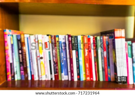 Blurred images of books on bookshelves