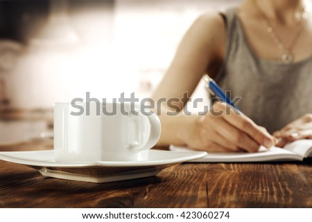 blurred interior of retro kitchen and coffee and woman  - stock photo