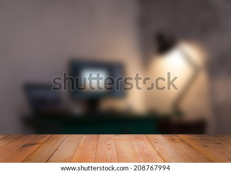 Blurred interior of room with wooden surface - stock photo