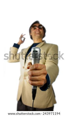 blurred interviewer holding a microphone over white background - stock photo