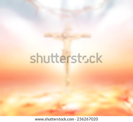 Blurred Jesus on the cross and crown of thorns over beautiful sunset background. - stock photo