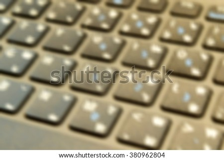Blurred keyboard background.