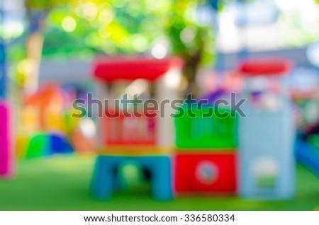 Blurred kid playing playground in park - stock photo