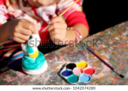 Blurred Kids Coloring Fun Night Time Children Painting Ceramic Statues In White