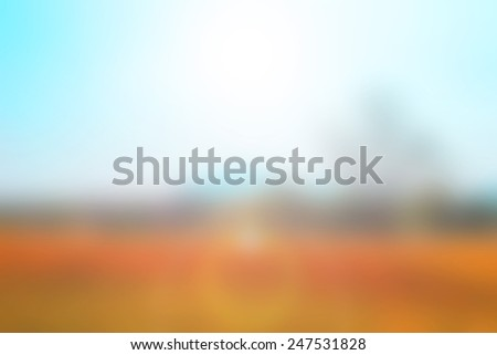 Blurred landscape background with sun flare  - stock photo