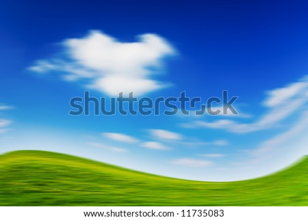 Blurred large piece of land and blue cloudy sky (can be used how background or wallpaper)