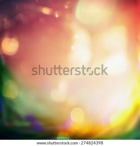 Blurred light green orange dawn nature bokeh background - stock photo