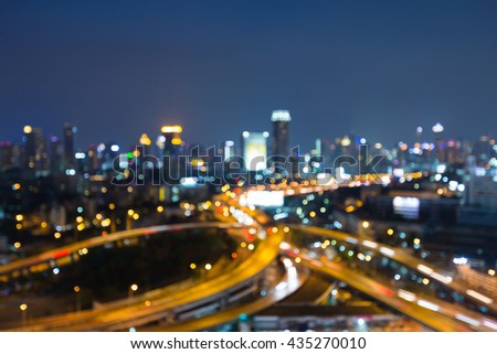 Blurred lights bokeh, Highway intersection and city business downtown background at night. abstract background - stock photo