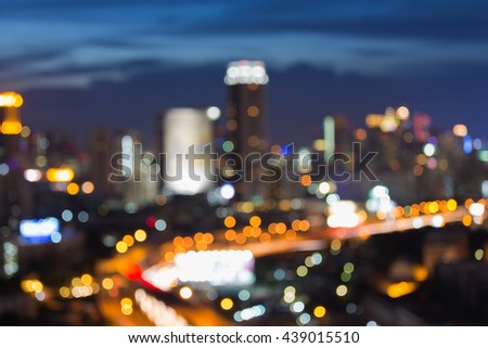 Blurred lights city downtown and highway at twilight, abstract background - stock photo