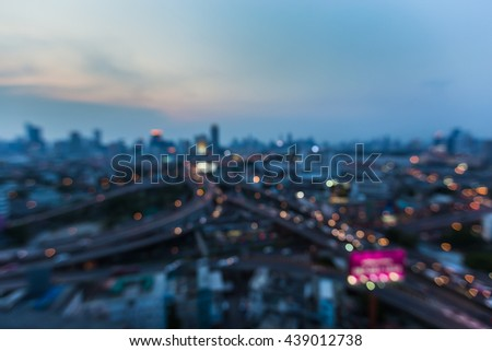 Blurred lights, city downtown background and highway interchanged after sunset - stock photo