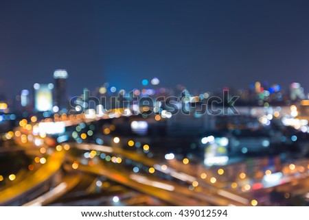 Blurred lights, city road interchanged and office building background, night view - stock photo