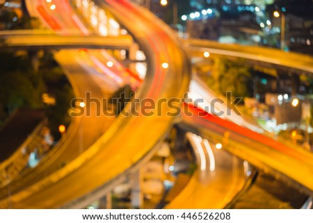 Blurred lights highway road intersection night view, close up abstract background - stock photo