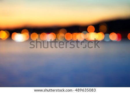 blurred lights of town on adriatic coastline after the sunset