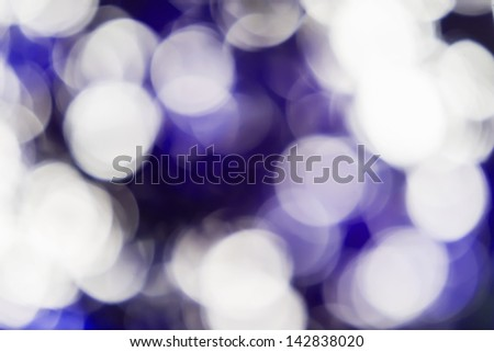 Blurred lights violet bokeh abstract light background - stock photo
