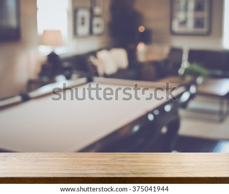 Blurred Living Room with Pool Table applying Retro Instagram Style Filter - stock photo