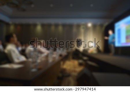 blurred man with projection screen conference room - stock photo