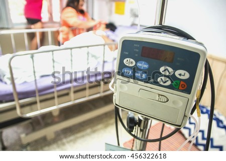 Blurred medical device patient in the recovery room.