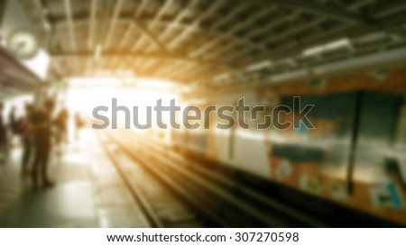 blurred metro station with people in sunset. - stock photo