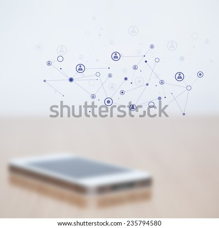 Blurred mobile phone  and added graphic connection icon - stock photo
