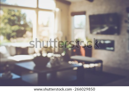 Blurred Modern Living Room with Television applying Retro Instagram Style Filter - stock photo