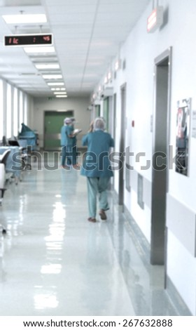 Blurred motion doctors and nurses walking in hospital corridor