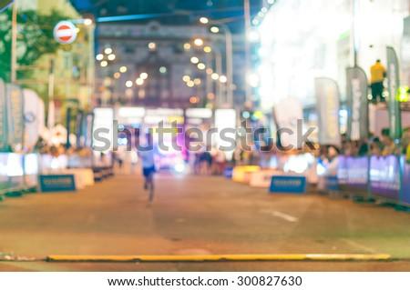 Blurred motion of alone night marathon runner. Sport background. - stock photo