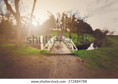 Blurred Nature Trail with White Bridge Background with Vintage Style Filter