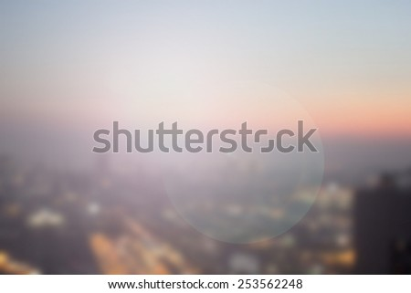 Blurred night city background with circle light.blur downtown construction structure backgrounds concept.blurry urban place sunset/sunrise hours wallpaper with lens flare glitter/sparkle round lights. - stock photo