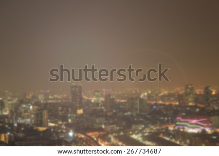 Blurred night city background with flare light . blur backgrounds concept