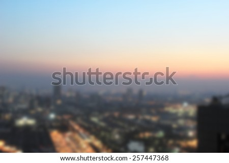Blurred night city space illuminated background.blurry evening firmament backdrop:abstract urban metropolis downtown view from rooftop pointing.out of focus dark building construction landscape night. - stock photo