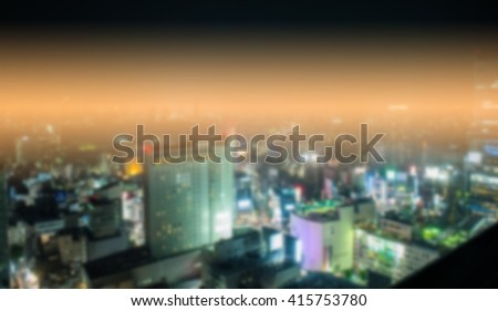 blurred night of tower and cityscape image near shibuya cross road area tokyo japan and cross process with soft flare filter - stock photo